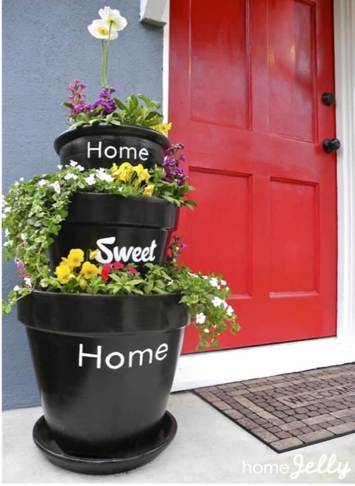A large terra cotta planter for the front door. A large clay pot display for the front door in black.
