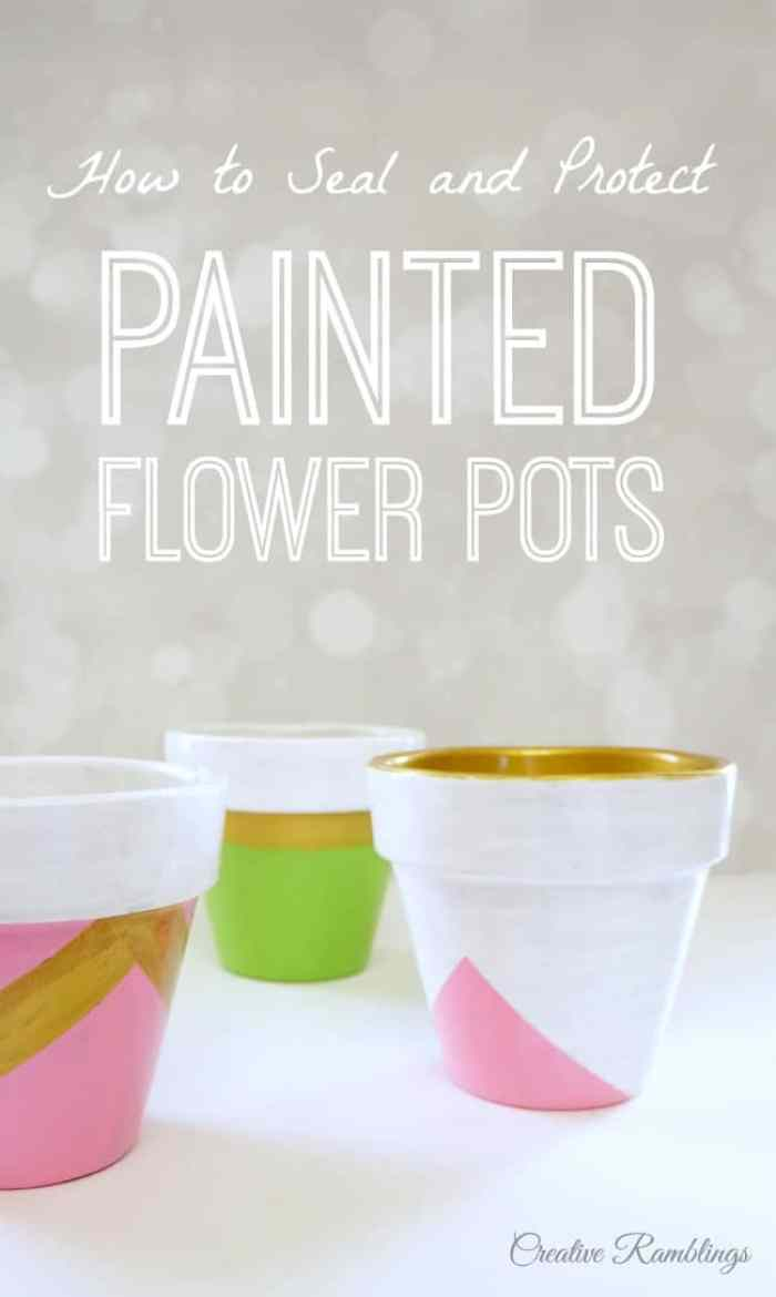Painted flower pots with pinks, greens, whites and metallic golds.