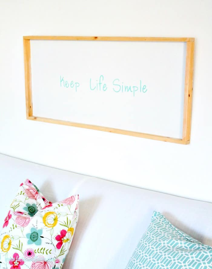 A DIY painted sign that says Keep Life Simple in turquoise letters with a white background. Keep life simple sign,  DIY signs,  DIY wood sign making,  DIY painted signs, DIY home decor signs, DIY summer decor