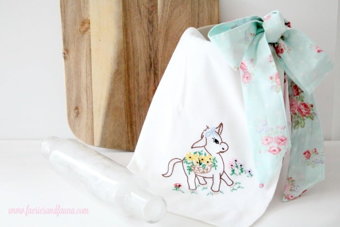 A handmade farmhouse style large tea towel apron.