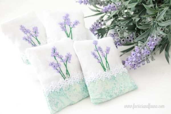 Four hand made embroidery crafts, with lavender.