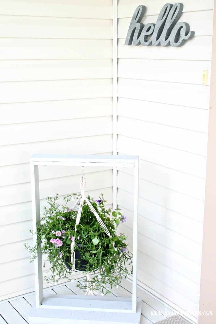 Front porch with a DIY plant hangar made as an easy woodworking project. DIY Wood Hanging basket for the front step. DIY Planters, DIY Pot hangers, DIY Hanging front porch decor, easy woodworking project, Pots, DIY Hanging flower pot, DIY outdoor hanging planter.