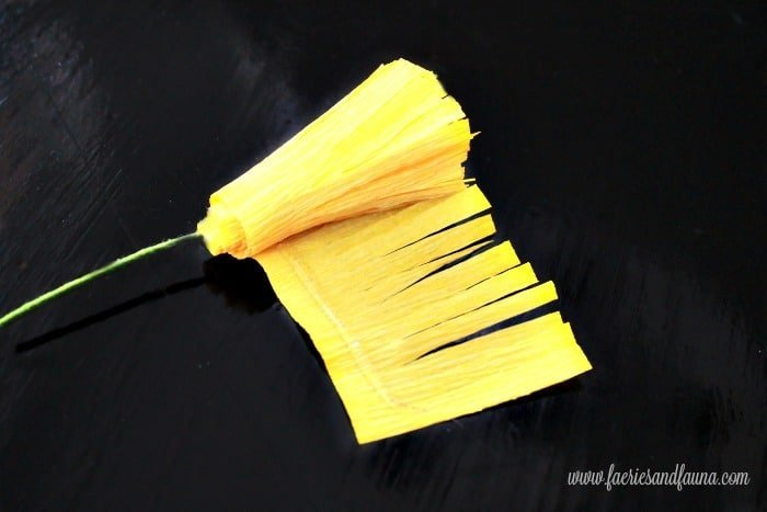Finishing the center portion of a crepe paper flower. Flower making, how to make paper flowers, flower making with crepe paper, minimalist wreath, elegant wreath, diy wedding decor, paper flowers wedding, book page crafts.