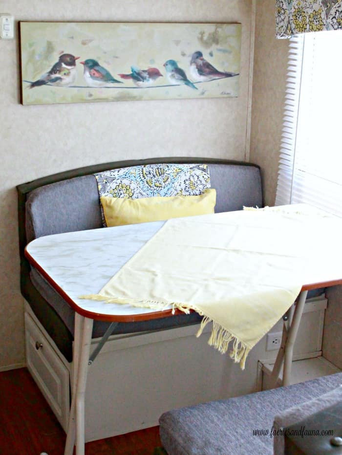Bench seat with a interchangeable panel for colour. RV cushion cover. RV renovation, RV interior, RV remodel before and after, travel trailer remodel ideas