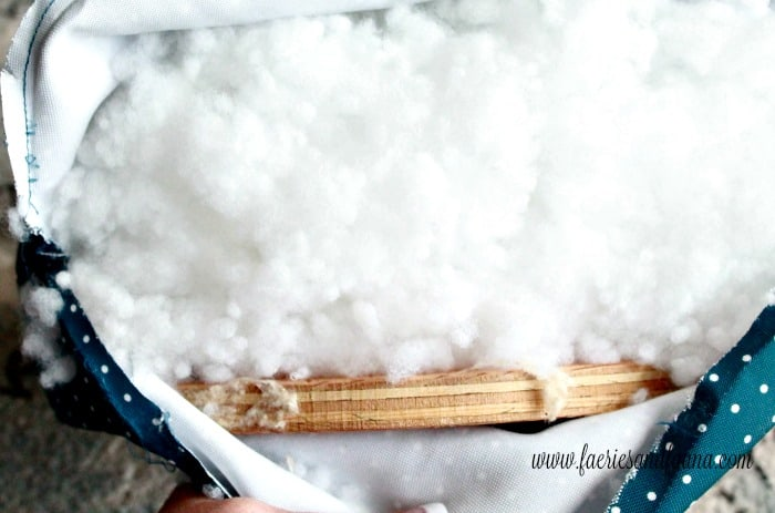 The stuffing inside a vintage stool cushion. How to fix a vintage stool, repairing a vintage stool, upcycled furniture, furniture for cheap, craft room makeover projects