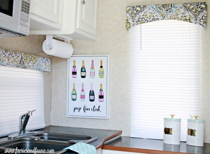 RV valances are given a makeover with new fabric in the kitchen as part of an RV interior, RV renovation,.
