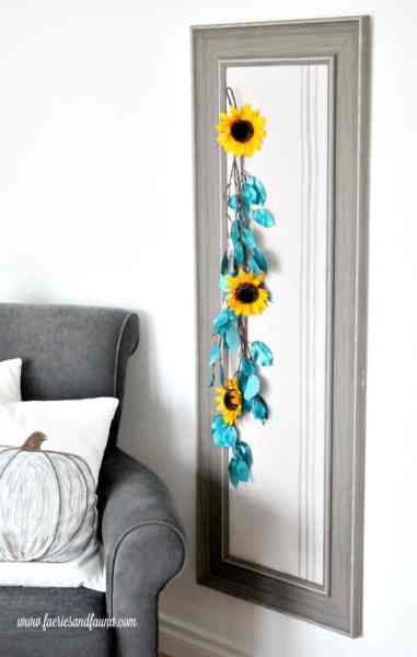 Full length decorative bulletin board using flowers.