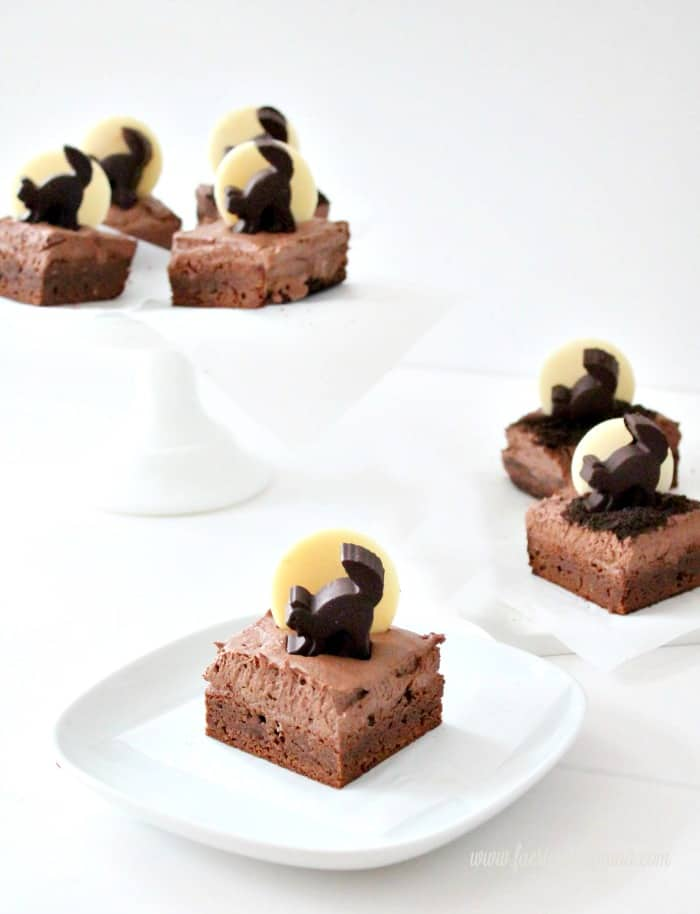 Halloween brownies with black cat silhouettes being served as a Halloween treat