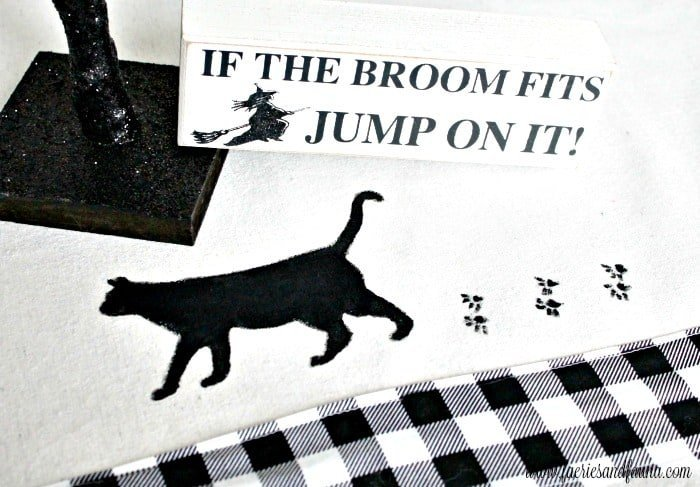 A handmade table runner for Halloween with a black cat. An easy and inexpensive pretty DIY Halloween decor idea.