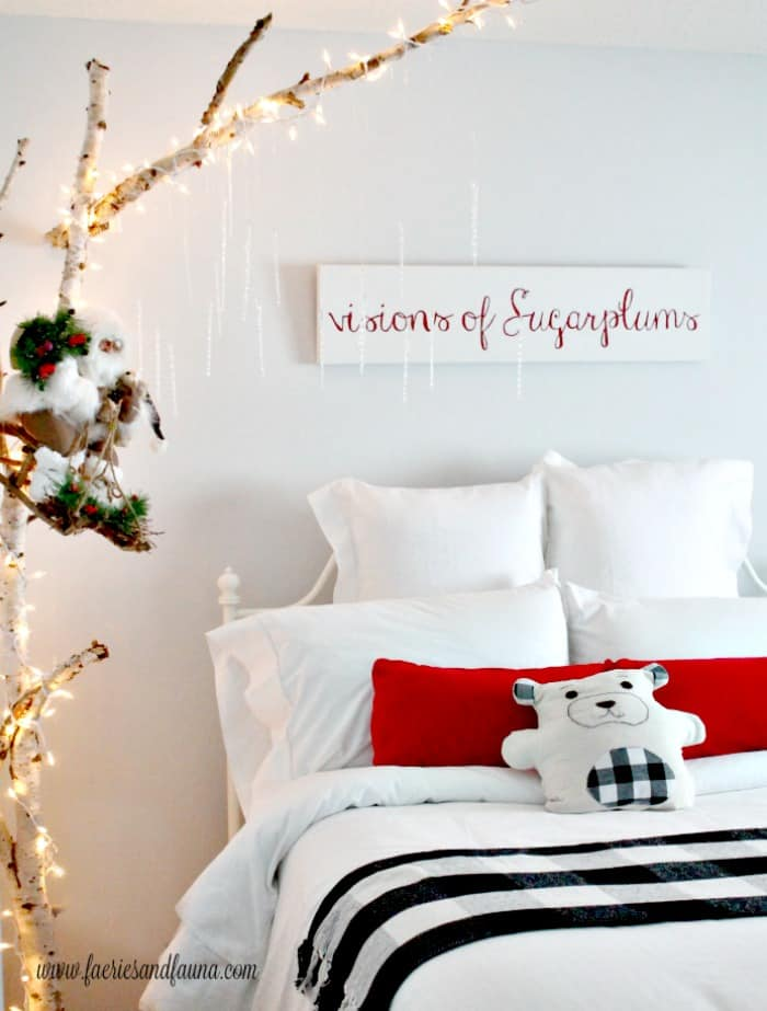 DIY Wood Sign for Christmas in a child's bedroom. The sign says visions of sugarplums