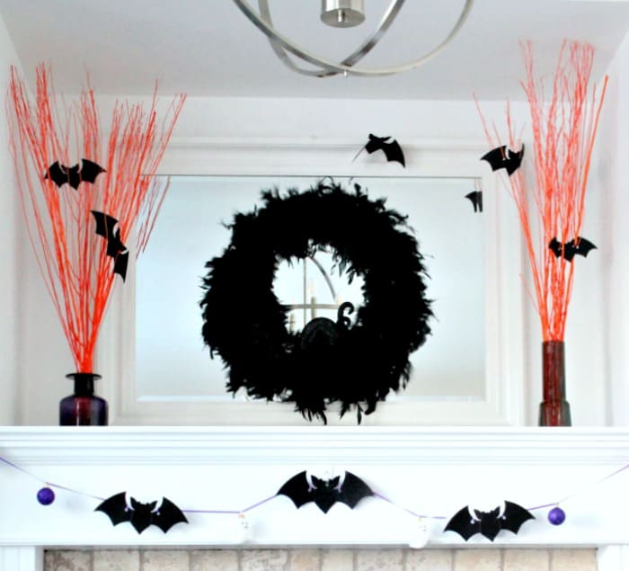DIY Halloween arrangements for the mantel made with an Easy Halloween Craft using branches and paint.