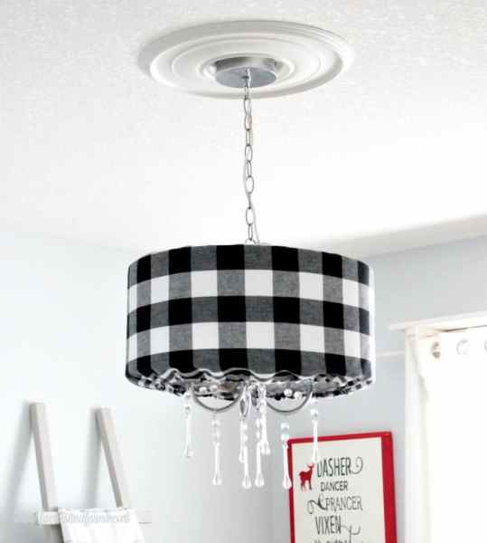DIY lampshade made using buffalo check white and black fabric.