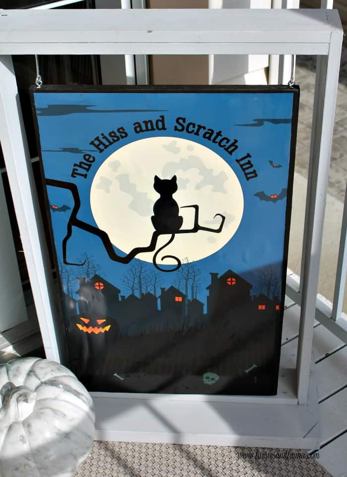Halloween DIY decoration for the front porch with black cats.
