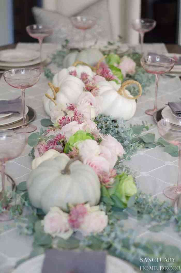 Soft pastel tablescape in muted soft colours and flowers.