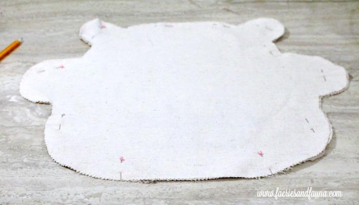 Pinning fabric pieces together on a DIY pajama bag.