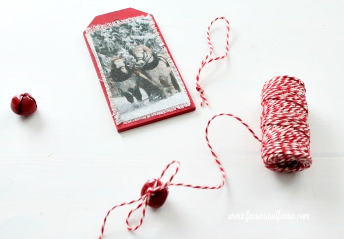 Adding twine and sleigh bells to a DIY Christmas ornament