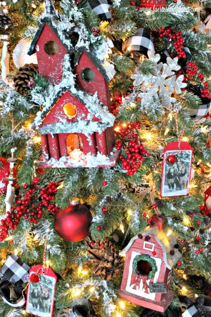 A large ornament on the front of a Christmas tree decorating idea.