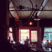 The interior of the restaurant complete with high wheel.