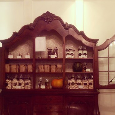 A vintage armoire used to display pre-packaged items in the bakery.