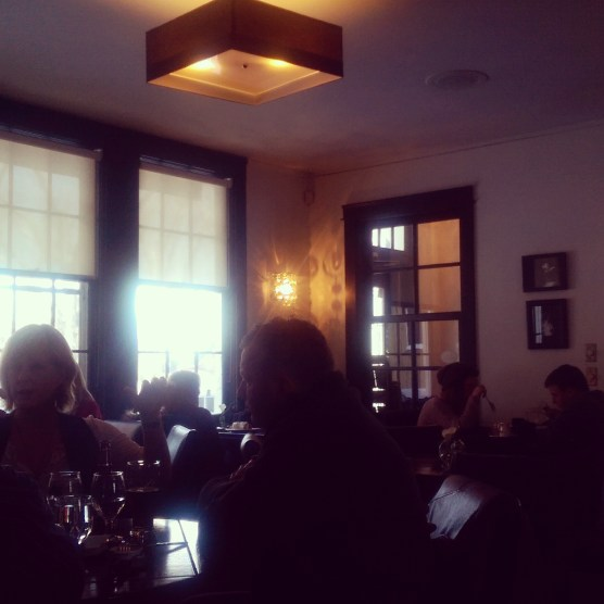 The sunlit interior of the restaurant, which is located in a house.