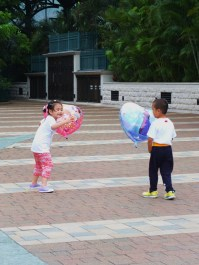 Children playing with their Disney balloons