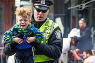 A Police Officer helping a child...and no guns