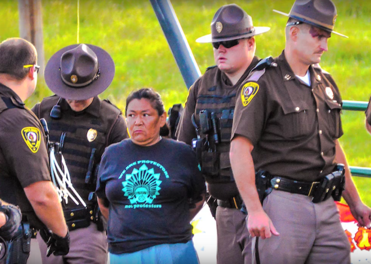 Dakota Access arrest in Neil Young's video 'Indian Givers' (screenshot: Slate)