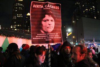 Protest sign featuring Berta Caceres. (cc photo: Joe Catron)