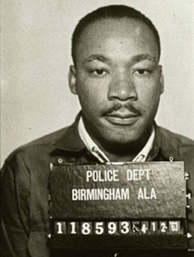 Martin Luther King being booked into the Birmingham jail