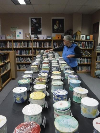 Doris Pfalmer checks on completed student work
