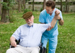 Physical therapist working with a senior man outdoors in the fresh air.