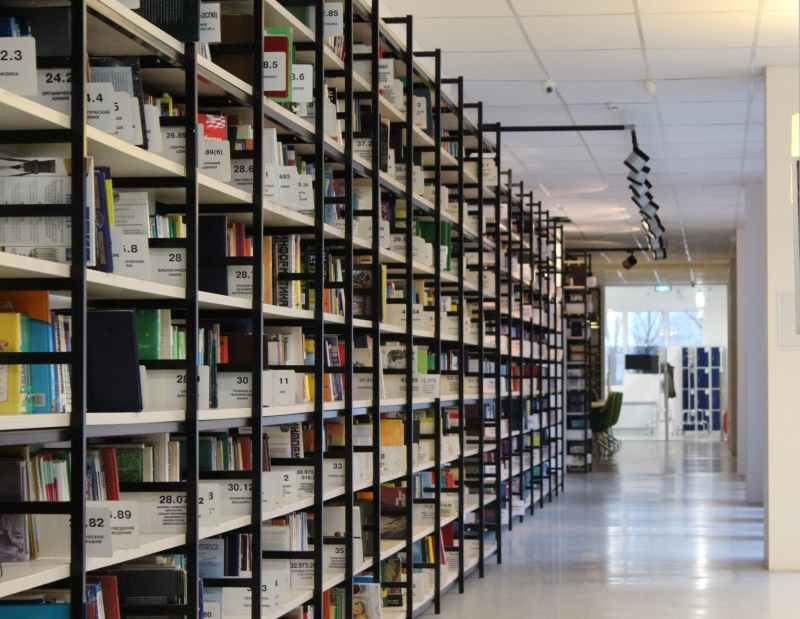 stack of books in shelf