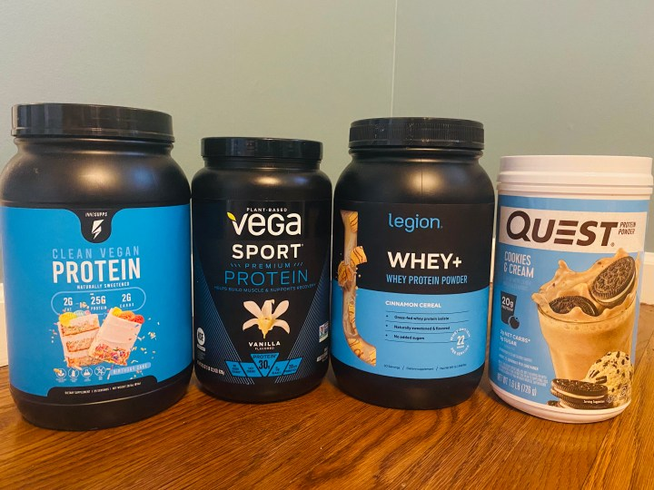 Tubs of different kinds of protein powder reviewed