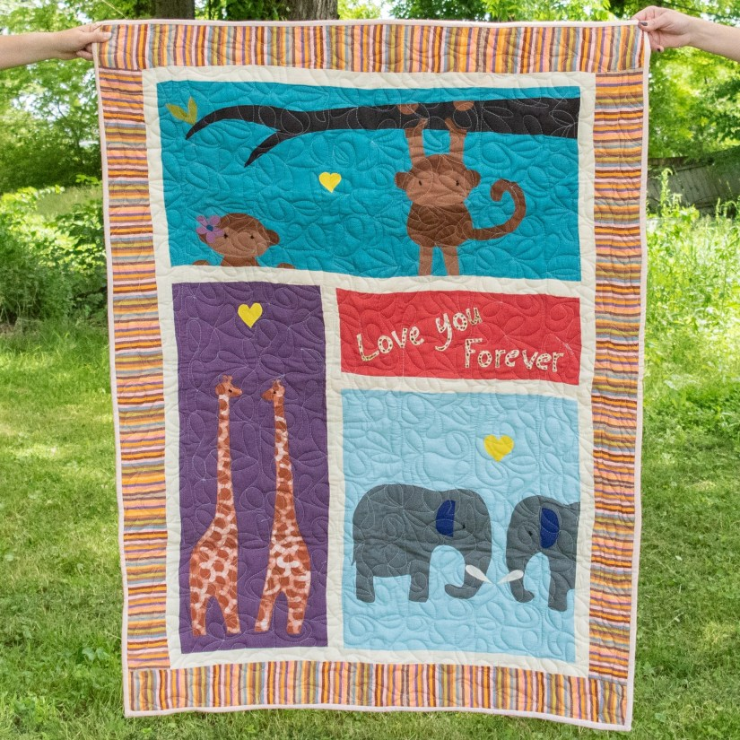 """Animal themed """"Love You Forever"""" baby quilt by Amani ya Juu - Fair Trade Home Goods made by artisans in Africa  