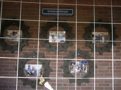 Photos of previous tours displayed at the entrance.