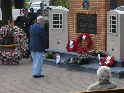 Timberwolf vet Bob presents the 104th Inf. Div. wreath.