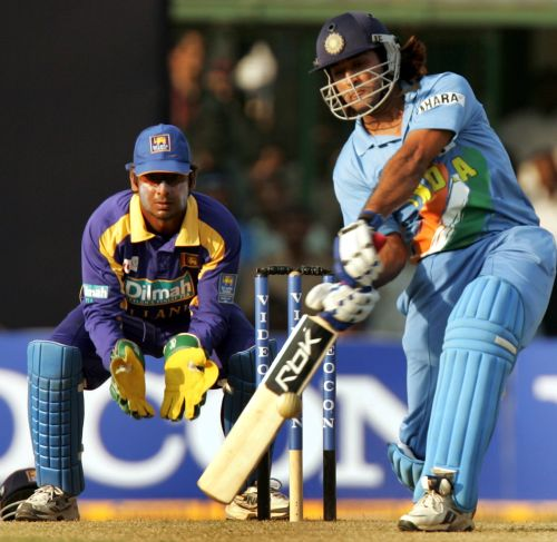 India's Mahendra Dhoni plays the winning shot during the fourth one-day international cricket match against Sri Lanka in Pune November 3, 2005. India won the seven one-day match series against Sri Lanka 4-0. REUTERS/Punit Paranjpe - RTR1A0FE