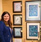 Ashley Howarth poses with her art.