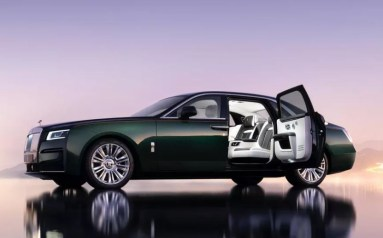 2021 Rolls Royce Ghost Extended green black color side view with open gate