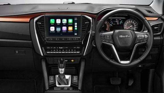 2nd generation Isuzu Mux suv steering wheel and infotainment screen close view