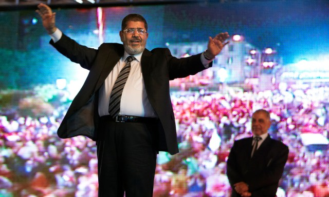 MAY 20, 2012 MOHAMMED MORSI OF EGYPT CELEBRATES (AP Photo/Fredrik Persson, File)