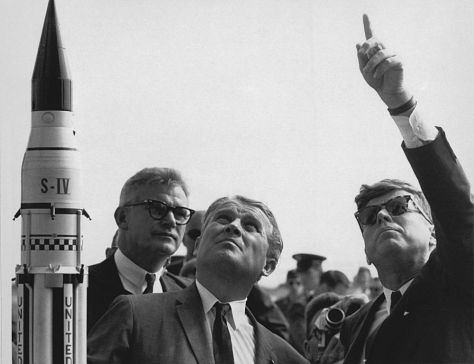 Date: 11.16.1963 Title: Seamans, von Braun and President Kennedy at Cape Canaveral Description: Dr. Wernher von Braun explains the Saturn Launch System to President John F. Kennedy.