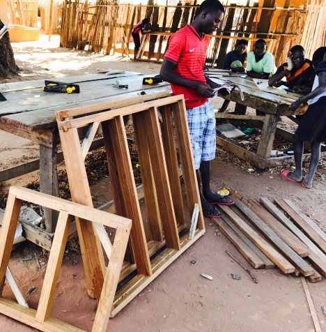 Carpenter with the window frames for the new building