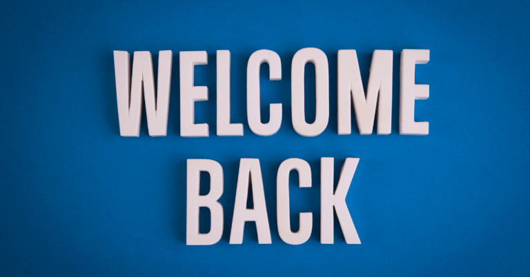 Welcome Back white letters on blue background