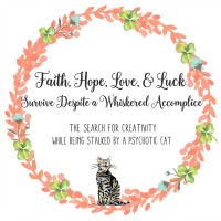 Faith, Hope, Love, & Luck Survive Despite a Whiskered Accomplice