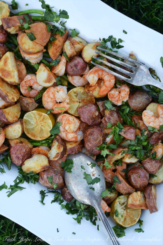 Red potatoes, asparagus, broccolini, and shrimp transform into the perfect one sheet pan meal with the addition of chipotle, lime juice, and melted butter.