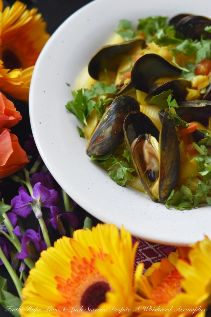 Light coconut milk and curry seasoning blend together with diced sweet yellow onion and tomato to make these fresh mussels flavorful and unforgettable.