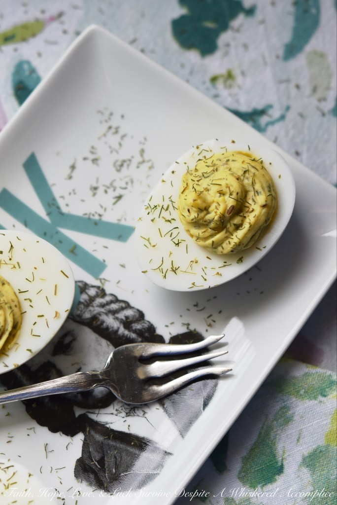 "Dill Weed Deviled Eggs - Make ordinary deviled eggs ""egg""traordinary with the addition of dill weed, pickle juice, mayonnaise, Dijon mustard, salt, pepper, and just a touch of sugar."