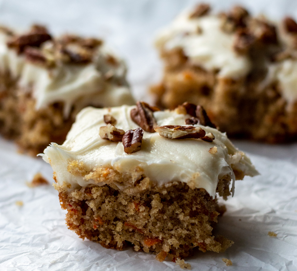 carrot cake slices with cream cheese icing and pecans