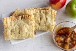 hand pies on a plate with apple filling in a bowl